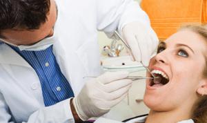 orthodontist checking between teeth